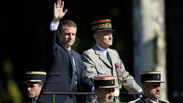 French President Emmanuel Macron and Chief of the Defence Staff French Army General Pierre de Villiers arrive in a command car for the traditional Bastille Day military parade on the Champs-Elysees in Paris, France, July 14, 2017. - Sputnik International