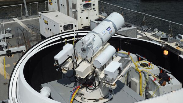 The Laser Weapon System (LaWS) temporarily installed aboard the guided-missile destroyer USS Dewey (DDG 105) in San Diego, Calif. - Sputnik International