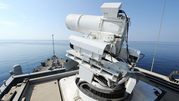 The Afloat Forward Staging Base (Interim) USS Ponce (ASB(I) 15) conducts an operational demonstration of the Office of Naval Research (ONR)-sponsored Laser Weapon System (LaWS) while deployed to the Gulf. File photo  - Sputnik International