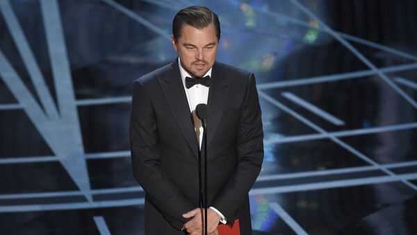 Leonardo DiCaprio presents the award for best actress in a leading role at the Oscars on Sunday, Feb. 26, 2017, at the Dolby Theatre in Los Angeles. - Sputnik International