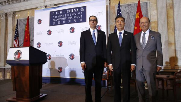 From left, Treasury Secretary Steve Mnuchin, Chinese Vice Premier Wang Yang, and Commerce Secretary Wilbur Ross pose for a group photograph before speaking at the opening of the U.S.-China Comprehensive Economic Dialogue, Wednesday, July 19, 2017, at the Treasury Department in Washington. - Sputnik International