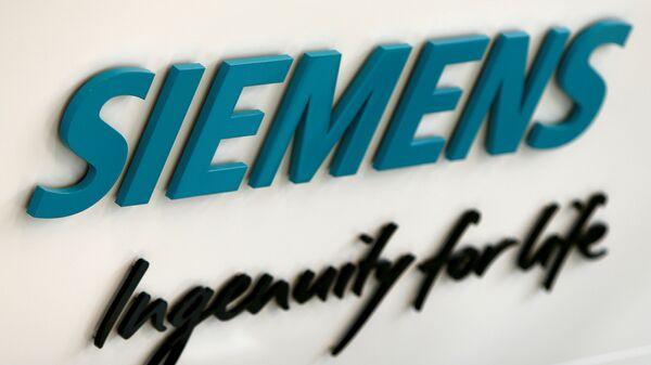 Siemens AG logo is seen in new headquarters in Munich, Germany, June 14, 2016 - Sputnik International