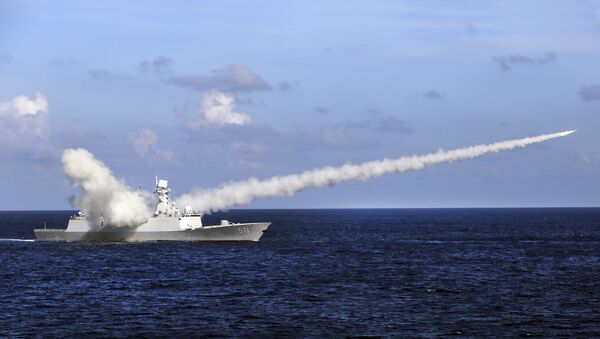 Chinese missile frigate Yuncheng launches an anti-ship missile during a military exercise (File) - Sputnik International