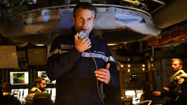 French president Emmanuel Macron speaks to the Captain and crew of the submarine Le Terrible from the operations centre of the vessel, whilst at sea on July 4, 2017 - Sputnik International