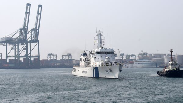 Indian Coast Guard Ship (ICGS) Shaunak a new offshore patrol vessel (L) is escorted by a tug as she arrives at port in Chennai on March 19, 2017, making her maiden visit after commissioning into the coastguard eastern fleet in Goa - Sputnik International