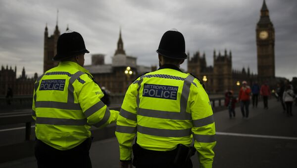 Police officers patrol Westminster Bridge with the Houses of Parliament in the background, on election day in London, Thursday, June 8, 2017. - Sputnik International