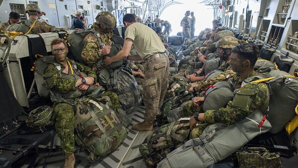 Paratroopers prepare for deployment onboard a US aircraft during the Swift Response 2017 international military exercise at Papa Airbase near Papa, 146 kms southwest of Budapest, Hungary, Tuesday, July 18, 2017. Swift Response is part of the Saber Guardian 2017 (SG17) multinational military exercise held annually in the Black Sea Region as part of the U.S. European Command Joint Exercise Program. The lead organizations for Saber Guardian 2017 are U.S. Army Europe and the Bulgarian Armed Forces. SG17 is co-hosted by the Bulgarian, Hungarian and Romanian land force components and it takes place in numerous locations across Bulgaria, Hungary and Romania in the summer of 2017 - Sputnik International
