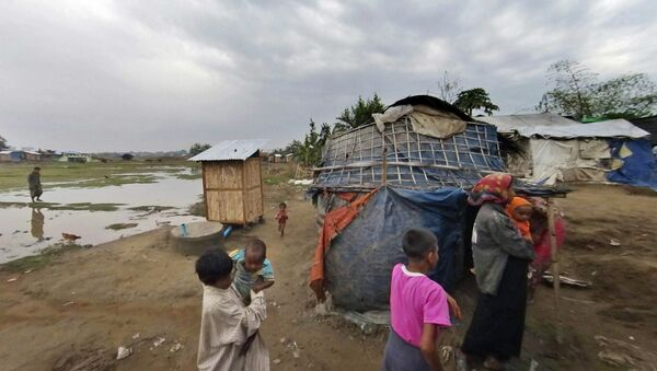 In this Friday, March 17, 2017, image made from video, people who identify themselves as Rohingya, walk at the Dar Paing camp, north of Sittwe, Rakhine state, Myanmar. More than 120,000 Rohingya were forced into camps five years ago, and their suffering may have only worsened since Nobel Peace laureate Aung San Suu Kyi rose to power in Myanmar last year. - Sputnik International