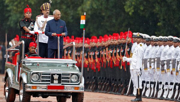 India's new President Ram Nath Kovind inspects an honour guard after being sworn in at the Rashtrapati Bhavan presidential palace in New Delhi, India July 25, 2017 - Sputnik International