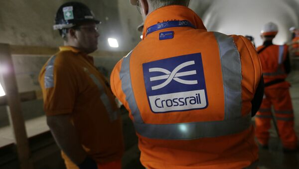Workers talk as tunnel boring machine Victoria breaks into the eastern end of the Liverpool Street Crossrail station in London, Tuesday, March 10, 2015. - Sputnik International