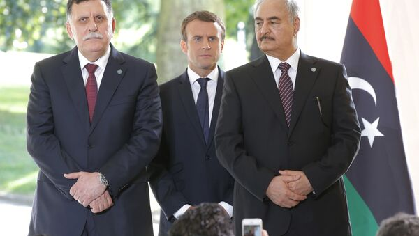 Libya's Prime Minister Fayez al-Sarraj of the U.N.-backed government, left, France's President Emmanuel Macron, center, and General Khalifa Hifter of the Egyptian-backed commander of Libya's self-styled national army shake hands listen to France's President Emmanuel Macron after a declaration at the Chateau of the La Celle-Saint-Cloud, west of Paris, France, Tuesday, July 25, 2017. - Sputnik International