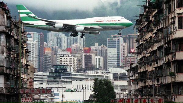 Hong Kong flag carrier Cathay Pacific, Boeing 747-400 jumbo jet, flies over the Kai Tak Airport control tower - Sputnik International