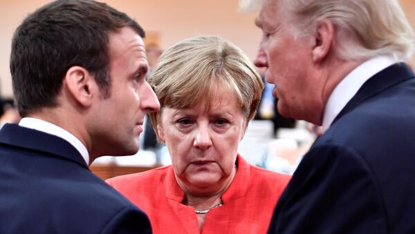 French President Emmanuel Macron, German Chancellor Angela Merkel and US President Donald Trump confer at the start of the first working session of the G20 meeting in Hamburg, Germany, July 7, 2017. - Sputnik International