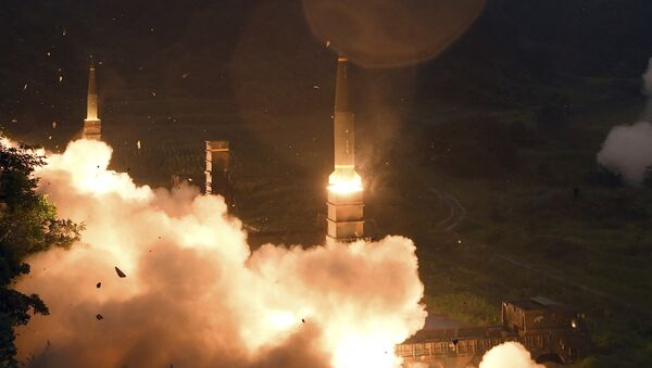In this photo provided by South Korea Defense Ministry, South Korea's Hyunmoo II Missile system fire missiles during the combined military exercise between the U.S. and South Korea against North Korea at an undisclosed location in South Korea, Saturday, July 29, 2017. - Sputnik International