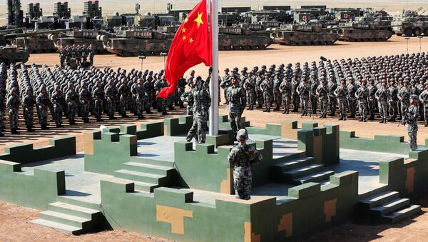 Soldiers of China's People's Liberation Army (PLA) raise a Chinese national flag during the military parade to commemorate the 90th anniversary of the foundation of the army at Zhurihe military training base in Inner Mongolia Autonomous Region, China, July 30, 2017 - Sputnik International