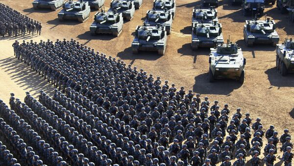 In this photo released by China's Xinhua News Agency, Chinese People's Liberation Army (PLA) troops march past military vehicles Sunday, July 30, 2017 as they arrive for a military parade to commemorate the 90th anniversary of the founding of the PLA on Aug. 1 at Zhurihe training base in north China's Inner Mongolia Autonomous Region - Sputnik International