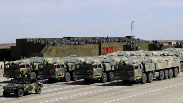 In this photo released by China's Xinhua News Agency, military vehicles carrying missiles for both nuclear and conventional strikes are driven past the VIP stage during a military parade to commemorate the 90th anniversary of the founding of the People's Liberation Army at Zhurihe training base in north China's Inner Mongolia Autonomous Region, Sunday, July 30, 2017 - Sputnik International