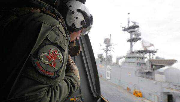 A crewman aboard a U.S. Marine MV-22B Osprey aircraft looks out as it lifts off the deck of the USS Bonhomme Richard amphibious assault ship off the coast of Sydney, Australia, Thursday, June 29, 2017 after a ceremony on board the ship marking the start of Talisman Saber 2017, a biennial joint military exercise between the United States and Australia - Sputnik International