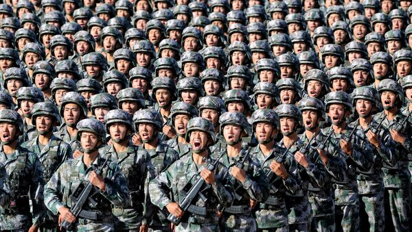 Soldiers of China's People's Liberation Army (PLA) get ready for the military parade to commemorate the 90th anniversary of the foundation of the army at Zhurihe military training base in Inner Mongolia Autonomous Region, China, July 30, 2017 - Sputnik International