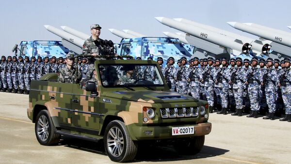 In this photo released by Xinhua News Agency, Chinese President Xi Jinping stands on a military jeep as he inspects troops of the People's Liberation Army during a military parade to commemorate the 90th anniversary of the founding of the PLA at Zhurihe training base in north China's Inner Mongolia Autonomous Region, Sunday, July 30, 2017 - Sputnik International