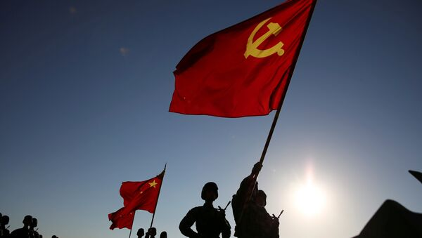 Soldiers carry a PLA flag and Chinese national flags before the military parade to commemorate the 90th anniversary of the foundation of China's People's Liberation Army (PLA) at Zhurihe military base in Inner Mongolia Autonomous Region, China, July 30, 2017 - Sputnik International