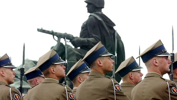 Polish Army soldiers stand to attention during a wreath laying ceremony marking the 62nd anniversary of the end of WWII in Europe, at the Soviet Army cemetery in Warsaw, Poland, Wednesday, May 9, 2007 - Sputnik International