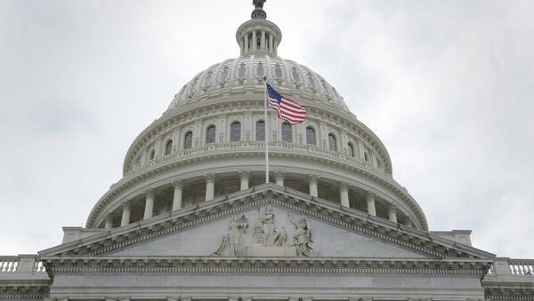 In this May 4, 2017, file photo, the U.S. flag flies in front of the Capitol dome on Capitol Hill in Washington - Sputnik International
