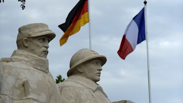 German flag and French flag are pictured in front of the War Memorial 1914-18, on May 27, 2016 in Verdun, eastern France - Sputnik International