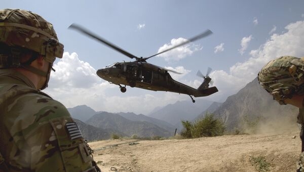 Soldiers with the U.S. Army's 2nd Battalion 27th Infantry Regiment based in Hawaii, pull security as a Blackhawk helicopter lands during an assessment mission to Observation Point Mace days after insurgents attacked four outposts in the area killing some two dozen members of Afghan security forces Saturday, July 9, 2011 in Kunar province, Afghanistan - Sputnik International