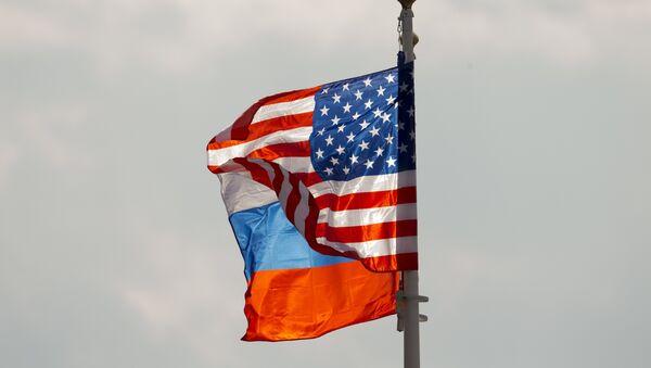 U.S. and Russian national flags wave on the wind (File) - Sputnik International