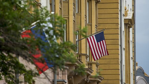 U.S. and Russian flags hung at the U.S. Embassy in Moscow, Russia, Friday, July 28, 2017 - Sputnik International