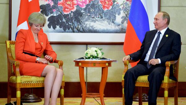 Russian President Vladimir Putin, right, listens to British Prime Minister Theresa May during a bilateral meeting in Hangzhou, China, Sunday, Sept. 4, 2016, ahead of the G20 Leaders Summit. - Sputnik International