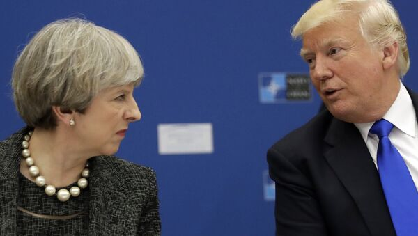 US President Donald Trump, right, speaks to British Prime Minister Theresa May during in a working dinner meeting at the NATO headquarters during a NATO summit of heads of state and government in Brussels on Thursday, May 25, 2017. - Sputnik International