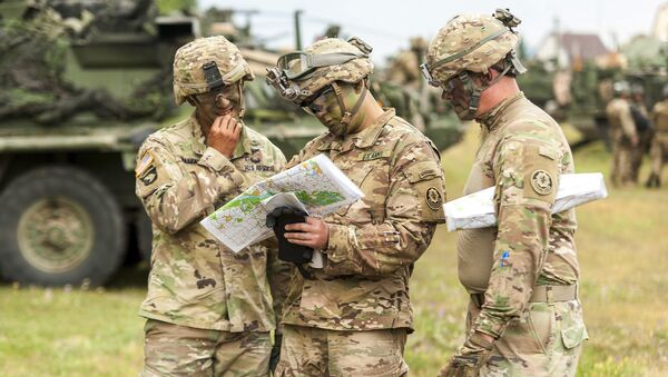 In this July 3, 2017 file photo, American soldiers get ready for NATO's Saber Guardian exercises, checking a map near Gyor, 120 kilometers west of Budapest, Hungary. - Sputnik International