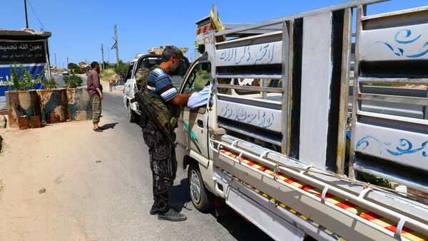 Members from a coalition of rebel groups called Jaish al Fateh, also known as Army of Fatah (Conquest Army), man a checkpoint in Idlib city, Syria July 18, 2017. Picture taken July 18, 2017 - Sputnik International