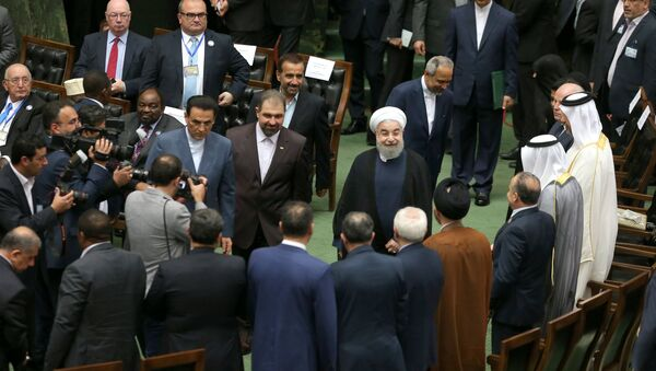 Iranian president Hassan Rouhani arrives for his swearing-in ceremony for a further term, at the parliament in Tehran, Iran, August 5, 2017 - Sputnik International