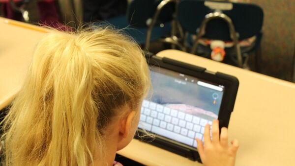 A child using a tablet - Sputnik International