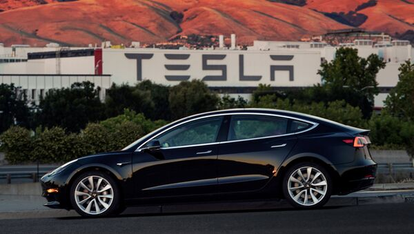 First production model of Tesla Model 3 out the assembly line is seen in this undated handout photo from Tesla Motors. - Sputnik International