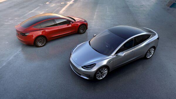 Tesla Motors' mass-market Model 3 electric cars are seen in this handout picture from Tesla Motors on March 31, 2016. - Sputnik International