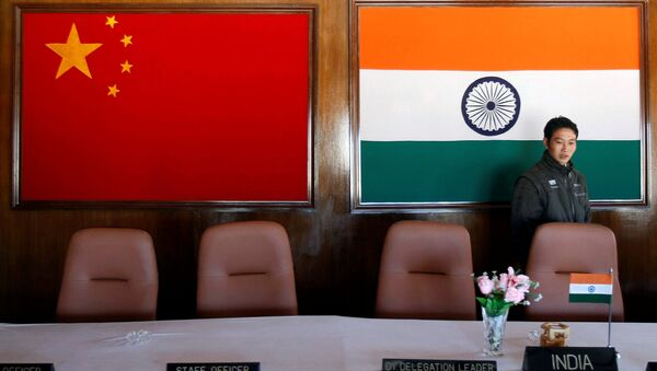 A man walks inside a conference room used for meetings between military commanders of China and India, at the Indian side of the Indo-China border at Bumla, in the northeastern Indian state of Arunachal Pradesh, November 11, 2009 - Sputnik International
