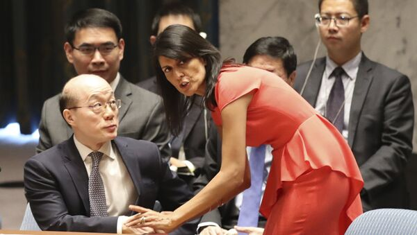 American Ambassador to the United Nations Nikki Haley, right, speaks to Chinese Ambassador to the United Nations Liu Jieyi before a Security Council vote on a new sanctions resolution that would increase economic pressure on North Korea to return to negotiations on its missile program, Saturday, Aug. 5, 2017 at U.N. headquarters - Sputnik International