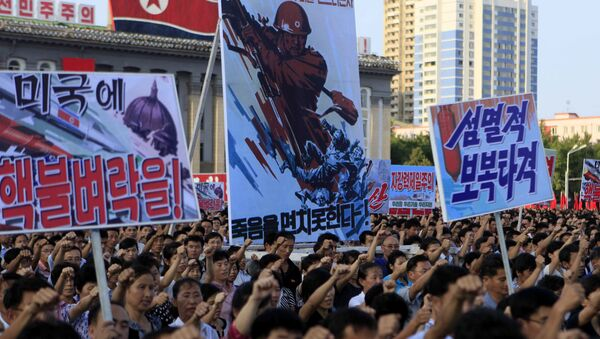 Tens of thousands of North Koreans gathered for a rally at Kim Il Sung Square carrying placards and propaganda slogans as a show of support for their rejection of the United Nations' latest round of sanctions on Wednesday Aug. 9, 2017, in Pyongyang, North Korea - Sputnik International