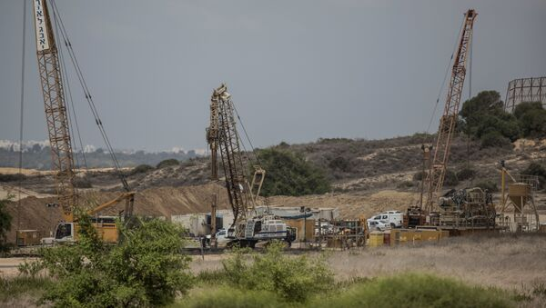 In this Thursday, Sept. 8, 2016 file photo, heavy machinery works on a massive underground barrier on the Israeli side of the border with Gaza - Sputnik International