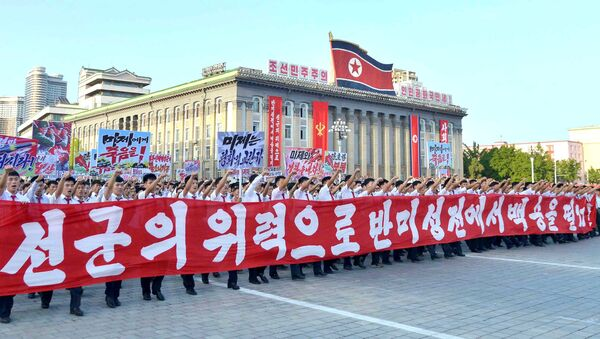 People participate in a Pyongyang city mass rally held at Kim Il Sung Square on August 9, 2017, to fully support the statement of the Democratic People's Republic of Korea (DPRK) government in this photo released on August 10, 2017 by North Korea's Korean Central News Agency (KCNA) in Pyongyang - Sputnik International