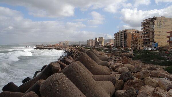 A picture taken on February 21, 2016 shows the sea shore of the eastern coastal Libyan city of Derna - Sputnik International