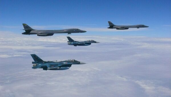 Two U.S. Air Force B-1B Lancers assigned to the 37th Expeditionary Bomb Squadron, deployed from Ellsworth Air Force Base, South Dakota, flew from Andersen Air Force Base, Guam, for a 10-hour mission, flying in the vicinity of Kyushu, Japan, the East China Sea, and the Korean peninsula, Aug. 7, 2017. - Sputnik International