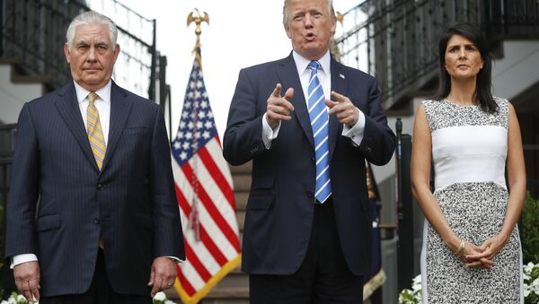 President Donald Trump gestures while speaking following his meeting with Secretary of State Rex Tillerson, left, and U.S. Ambassador to the United Nations Nikki Haley at Trump National Golf Club in Bedminster, N.J., Friday, Aug. 11, 2017. - Sputnik International