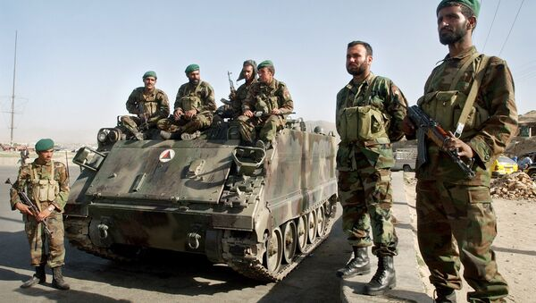 Afghan National Army soldiers stand near an armored military tank at a square in Kabul, Afghanistan on Tuesday, May 30, 2006. - Sputnik International