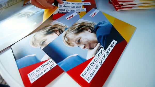 Brochures, showing German Chancellor Angela Merkel, top candidate of the Christian Democratic Union Party (CDU) are seen during an election rally for the upcoming federal elections in Gelnhausen, near Frankfurt, Germany August 14, 2017 - Sputnik International