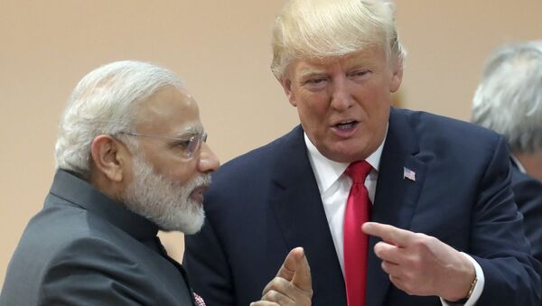India's Prime Minister Narendra Modi, in conversation with U.S. president Donald Trump during a working session of the G20 summit in Hamburg, Germany, Saturday, July 8, 2017 - Sputnik International